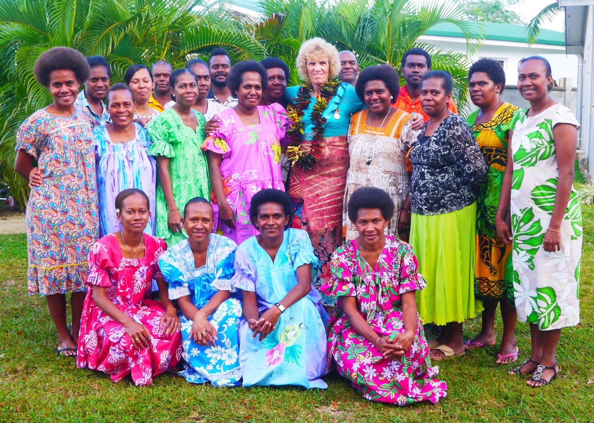 Port Vila International School staff celebrate Principal Mrs. Faye Taylor's achievement.